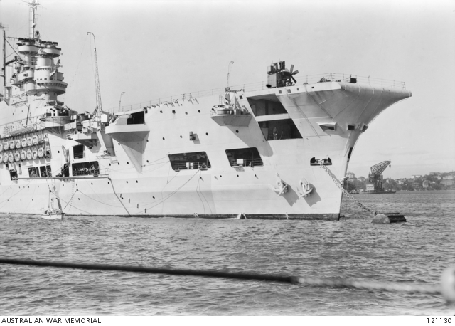 The Australian War Memorial asserts this ship is HMS INDEFATIGABLE before casting off from Sydney Harbour on 28 July, 1945. It is, however, clearly the maintenance carrier HMS Unicorn.