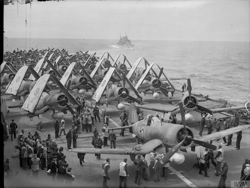 Fleet Air Arm Chance-Vought Corsair fighters, with Fairey Barracuda torpedo bombers behind, ranged on the flight deck of HMS FORMIDABLE, off Norway.