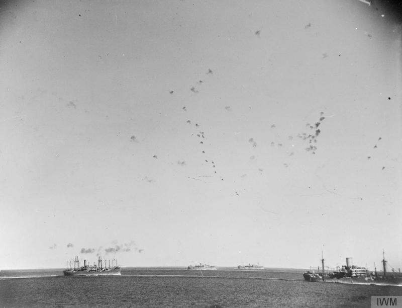 The sky is filled with anti-aircraft shells as the convoy steams on to Malta.