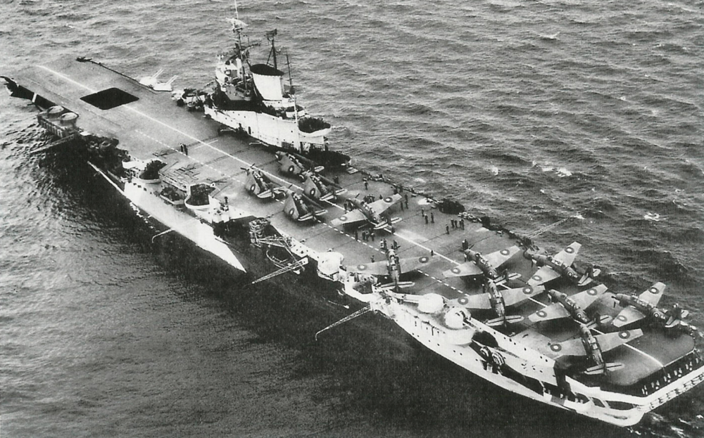 Indomitable in April 1944 carrying Hellcats and Avengers.