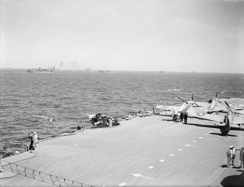 A deck park of Sea Hurricanes protected by the crash-barrier (foreground) aboard HMS INDOMITABLE.