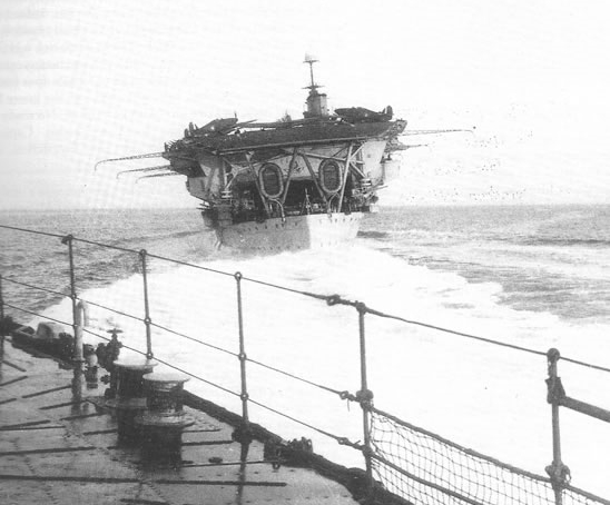 Hurricanes of No 46 Squadron RAF park on HMS Glorious' aft flight deck after successfully landing on without any arrester hooks or pilot deck experience.