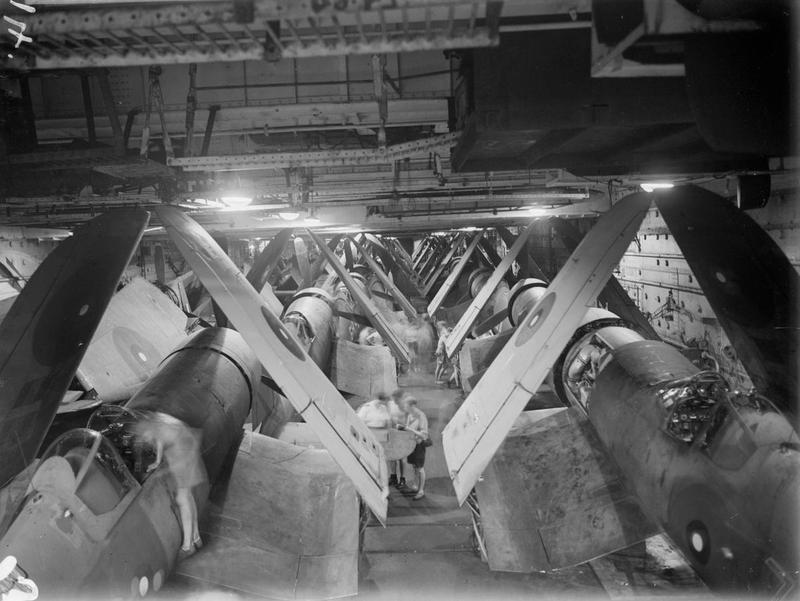 A tight fit; Corsairs in the hangar of HMS ILLUSTRIOUS. May 1944, in the Indian Ocean with the Eastern Fleet.