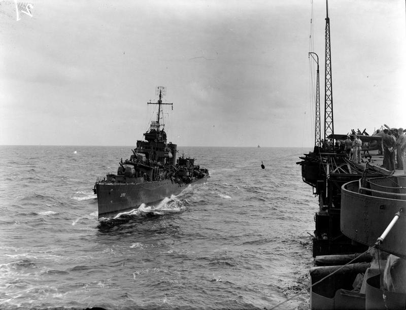 A US destroyer comes alongside 'USS Robin' (HMS VICTORIOUS).