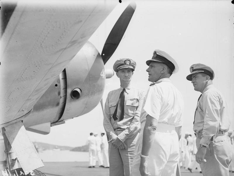 Capt John D Cassidy, Admiral Somerville, and Commander Coldwell on board the SARATOGA in Trincomalee habour.