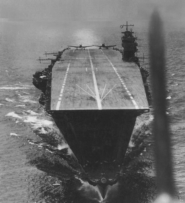 Japanese aircraft carrier Akagi on April 5, 1942 during the Indian Ocean Raid as seen from a Kate that has just taken off from her deck. The aircraft on the flight deck preparing for takeoff are also B5N Kates. Kure Maritime Museum photo
