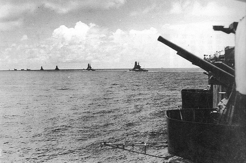 The carriers and battleships of the Japanese Indian Ocean strike force departing Starling Bay, marked as being taken on March 30. A translation of the original caption reads: March, 1942: the task force proceeding across the Indian Ocean: the view, from behind an anti-aircraft gun, front port side of the Zuikaku, shows the battle group in a single column, veering to port directly in front of he Zuikaku, with the carrier Akagi in the lead, followed by carriers Hiryu and Soryu, then battleships Hiei, Kirishima, Haruna and Kongo. The Shokaku is probably cruising to the rear of the Zuikaku