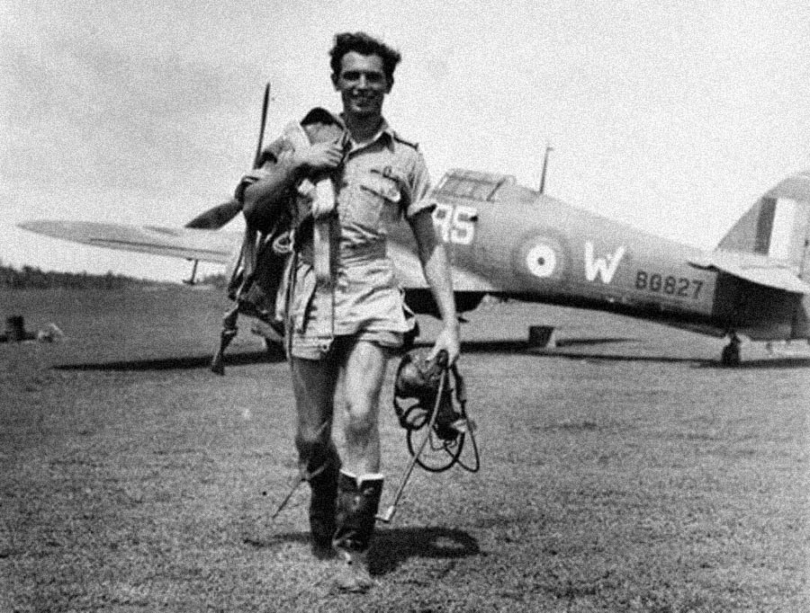 "Pilot Officer Jimmy Whalen, RCAF, one of the RAF 30 Squadron defenders of Ceylon, walks from his Hawker Hurricane IIB ""RS-W"" on April 5, 1942, the day after he claimed three Japanese aircraft shot down. Source: Imperial War Museum"