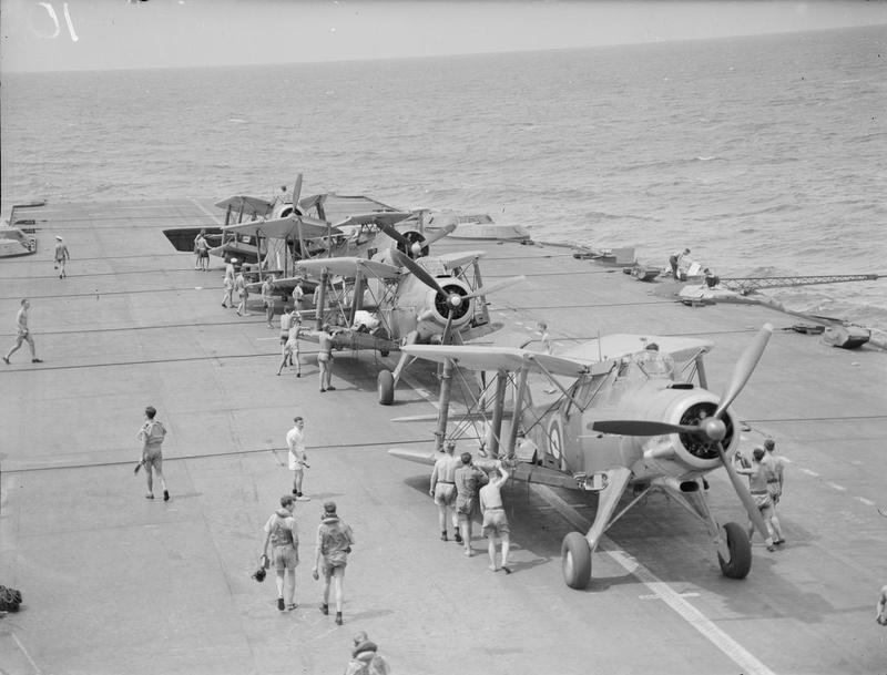 Albacores are arranged on HMS INDOMITABLE's flight deck from the forward and aft lifts.