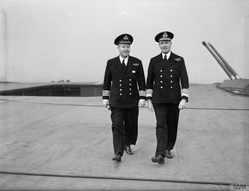 Captain A L Bisset, RN, Captain of HMS FORMIDABLE, and Admiral Sir James Sommerville seen walking on the flight deck of HMS FORMIDABLE.