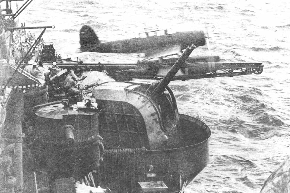 An Aichi E13A recon seaplane launches from the portside catapult of the Myōkō-class cruiser Ashigara