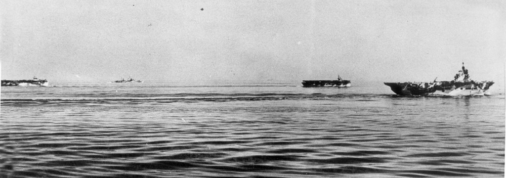 HMS BATTLER, ATTACKER and UNICORN with the cruiser EURYALUS in the glassy waters off Salerno.