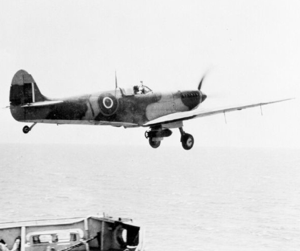 A Seafire III from HMS KHEDIVE carries a 500lb bomb during Operation Dragoon.