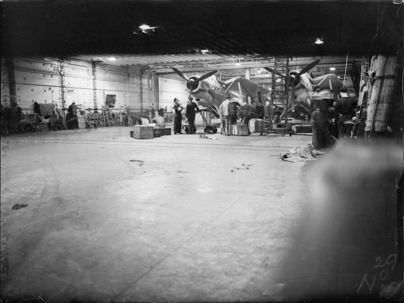 HMS VICTORIOUS, September 1942: Fairey Albacores stowed with folded wings in the hangar below the flight deck.