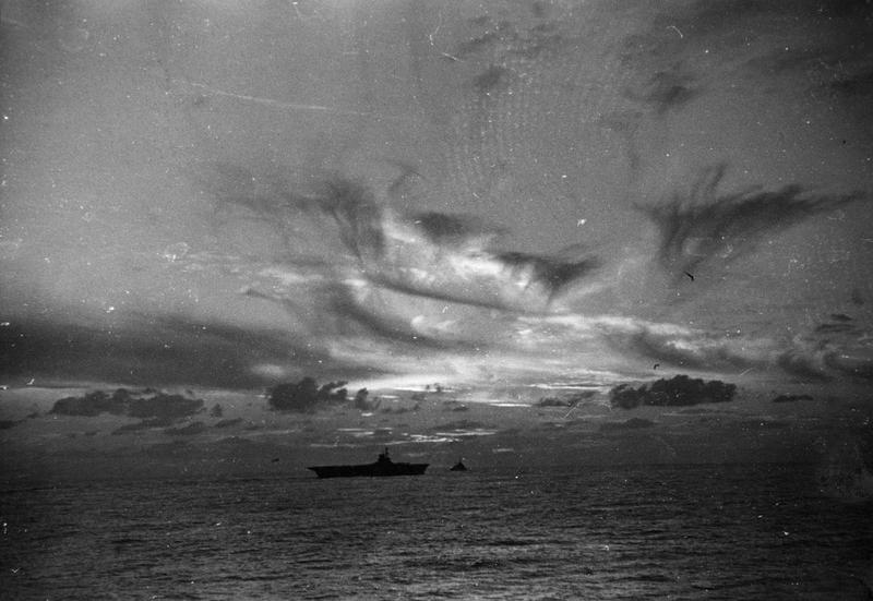 HMS ARK ROYAL at dusk in November 1940, from the deck of HMS SHEFFIELD.