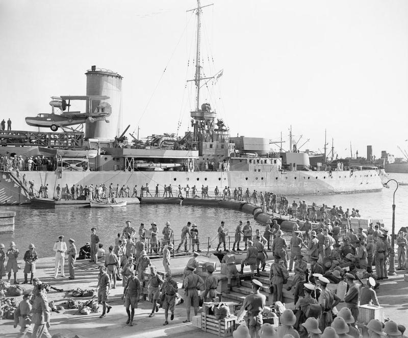British troops embark the Modified Leander-class light cruiser HMAS SYDNEY en route for Crete