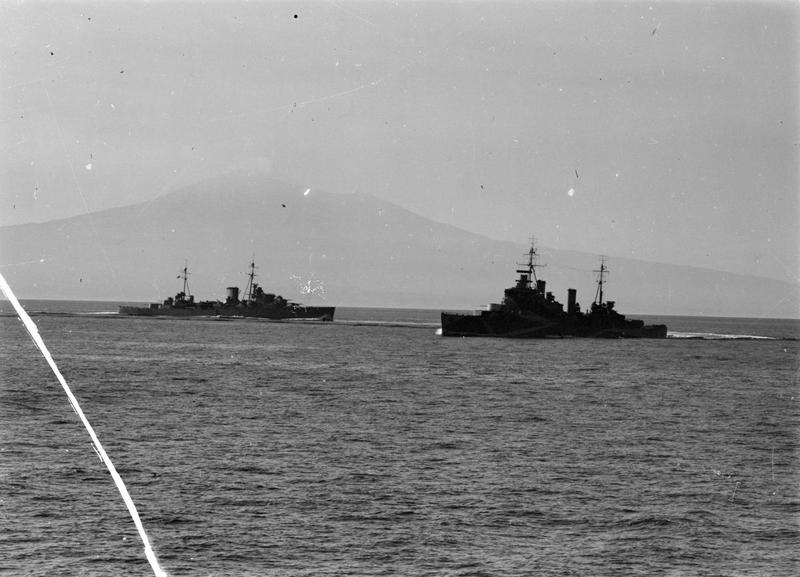 HMS ORION, left, with a modified Town class cruiser operating off Italy.