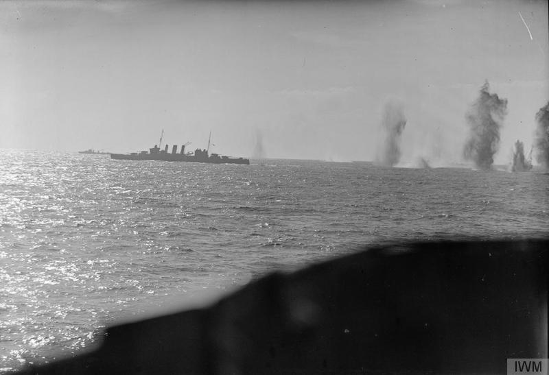 Bombs fall astern of HMS Berwick in November 1940.