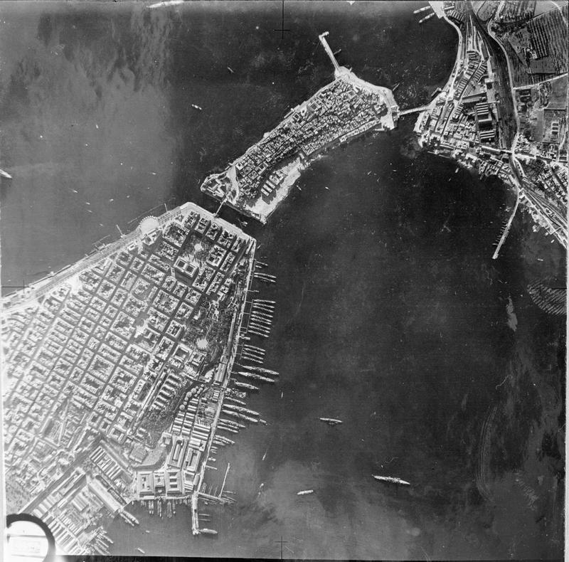 The line of destroyers and cruisers arrayed along the quay in Mar Piccolo, as captured by a Maryland reconnaissance flight shortly before Operation Judgement.