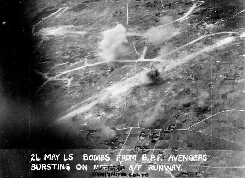 Bombs from British Fleet Avengers bursting on the runway of a Sakishima airfield.