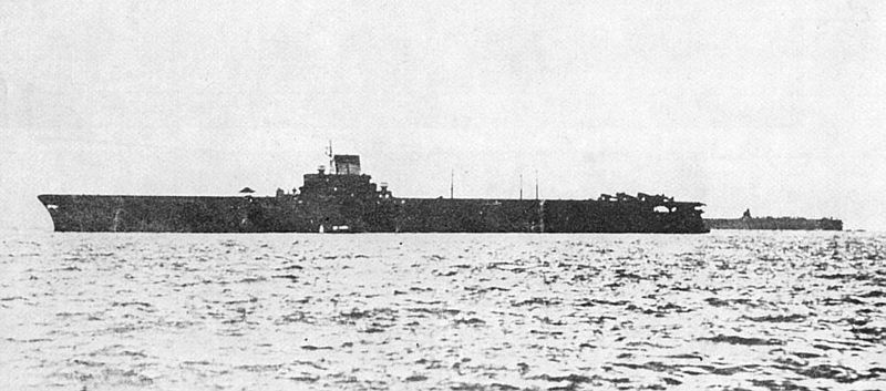 IJN Taiho at Tawitawi, Borneo, May 15-16, 1944. A tent has been positioned in the middle of her flight deck forward of the island to offer some protection from the searing tropical sun to her deck crew.