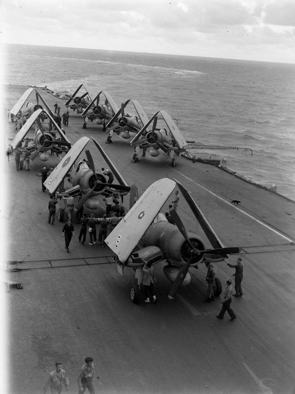 On board an Eastern Fleet carrier during the strike on Belawan Deli. Chance-Vought Corsair fighters are ranged on the flight deck. HMS ILLUSTRIOUS' ship's cat can be seen on the right centre of the photo.