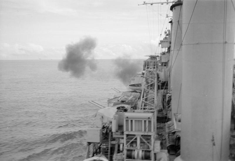 HMS SUFFOLK fires a broadside at Car Nicobar, during the concerted bombardment of the island.
