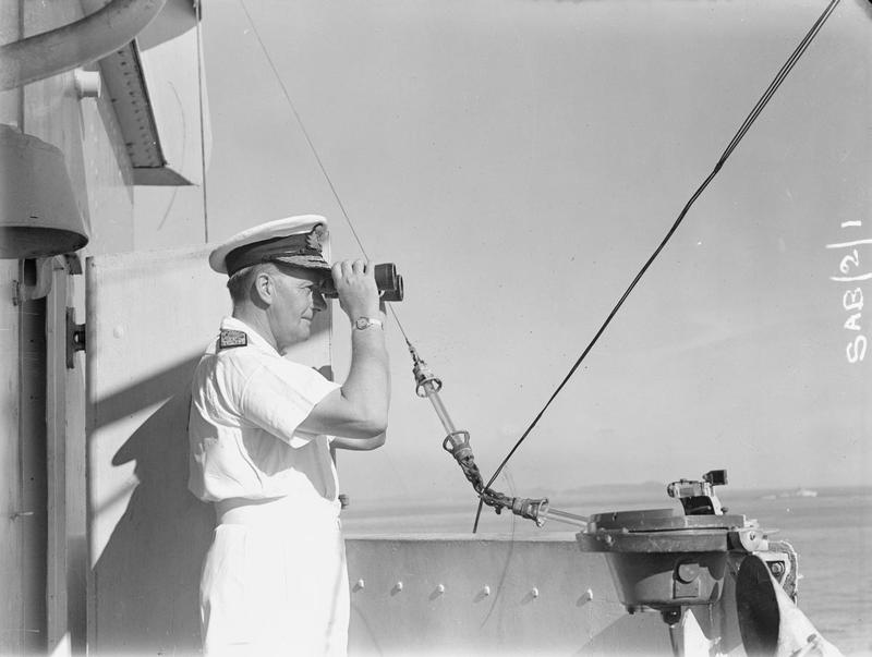 Admiral Sir James Somerville, C in C Eastern Fleet, watches operations from the bridge of HMS QUEEN ELIZABETH.
