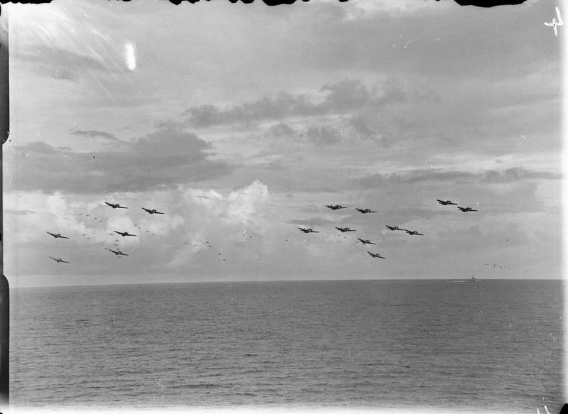 Fleet Air Arm aircraft based on HMS INDEFATIGABLE forming up in the air for the strike on a Japanese oil refinery at Pangkalan Brandan, Sumatra.
