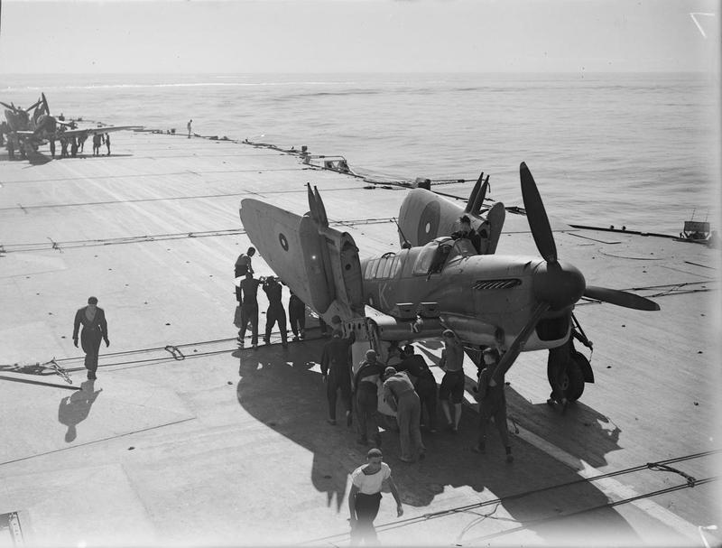 Deck crews folding the wings of a Firefly on its return from the strike.