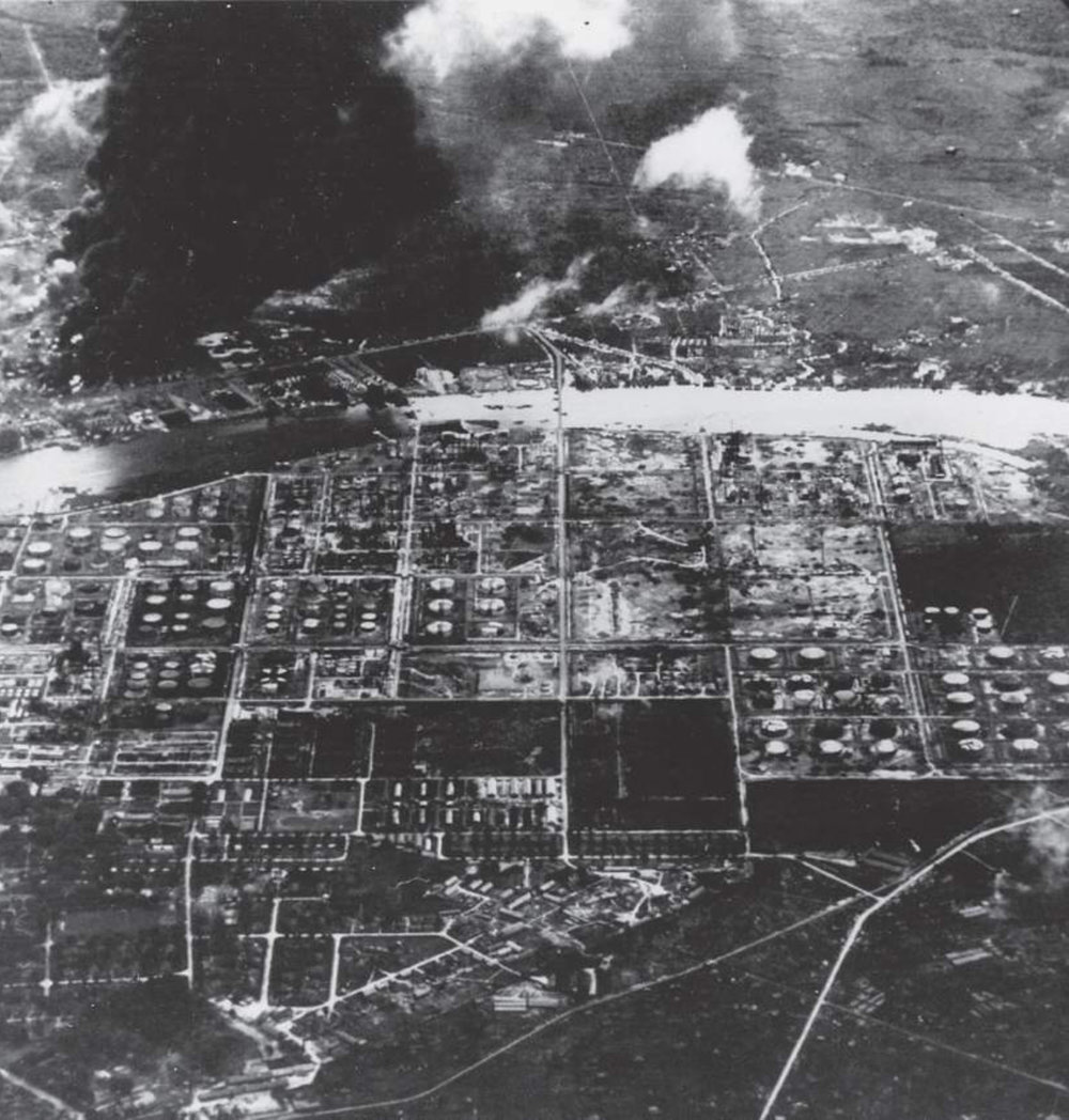 A post-strike photograph showing the fires spreading within Songei Gerong refinery. The damage caused days earlier to the Pladjoe refinery can be seen in the foreground.