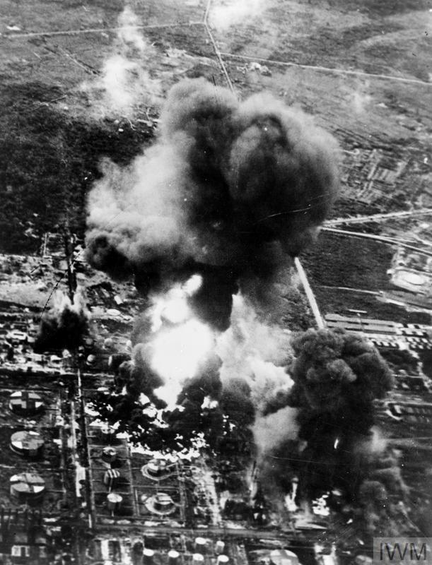 Bombs detonate and burning fuel begins to spread through the Pladjoe refinery in this photo, taken as the air strike unfolded.