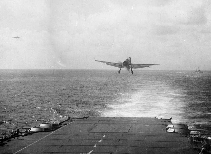 An Avenger coming to land on ILLUSTRIOUS after bombing Japanese oil refineries at Palembang.
