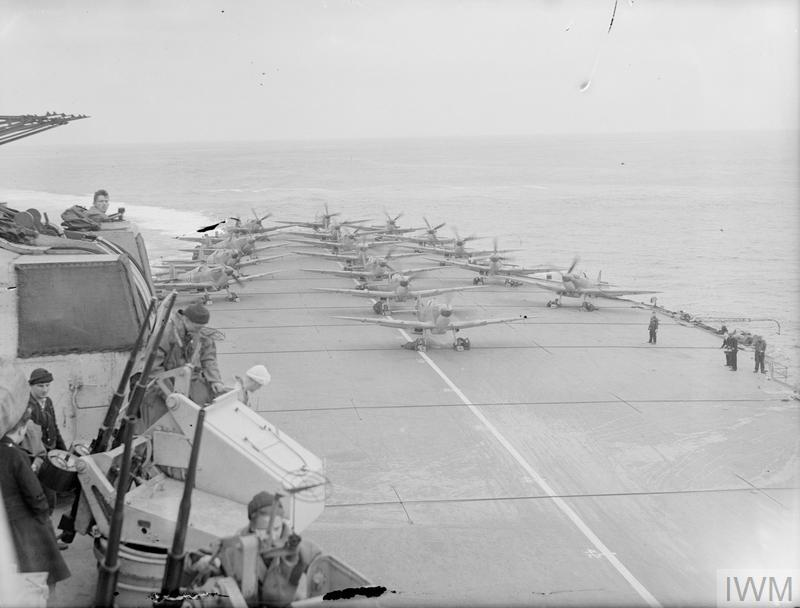 Seafires warm up on the deck aboard HMS INDEFATIGABLE.