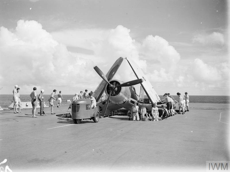 A Corsair about to be moved off HMS ILLUSTRIOUS' aft lift.