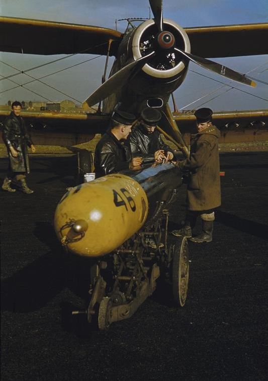 Royal Air Force cadets loading a torpedo onto an Albacore aircraft during training at Riddle Aerodrome. The Albacore was intended to operate as a torpedo bomber at night, like the Swordfish.
