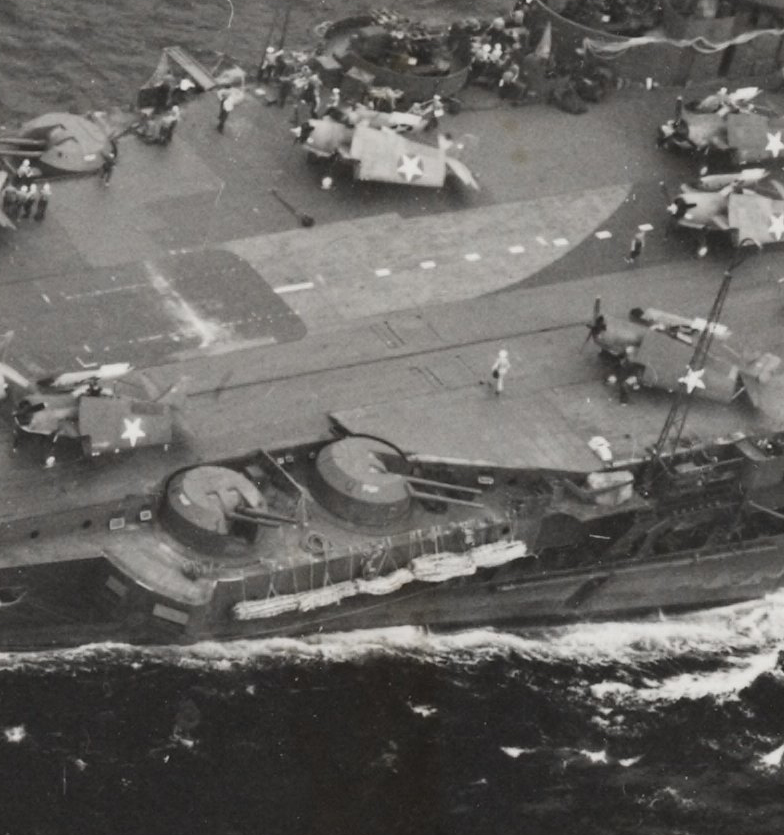 A close-up showing the bulged deck 'faring' placed about and behind B2 4.5in turret. This may have been to improve aircraft ranging around the accelerator and forward lift. Photos attributed to Operation Pedestal in August 1942 indicate this faring may have been in place before VICTORIOUS's sojourn as USS ROBIN.