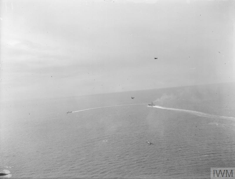 Fairey Albacores engaged in a mock torpedo attack against HMS FORMIDABLE off the coast of Mombasa.