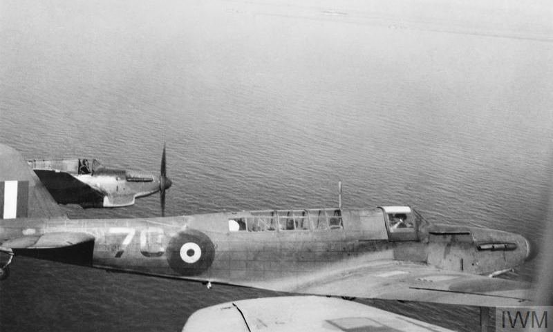 Two Fairey Fulmar Mark Is of No. 803 Squadron from HMS FORMIDABLE, photographed from a third while flying to HMS EAGLE during February 1941. This detachment augmented EAGLE's Fighter Flight in providing cover for a Malta convoy.
