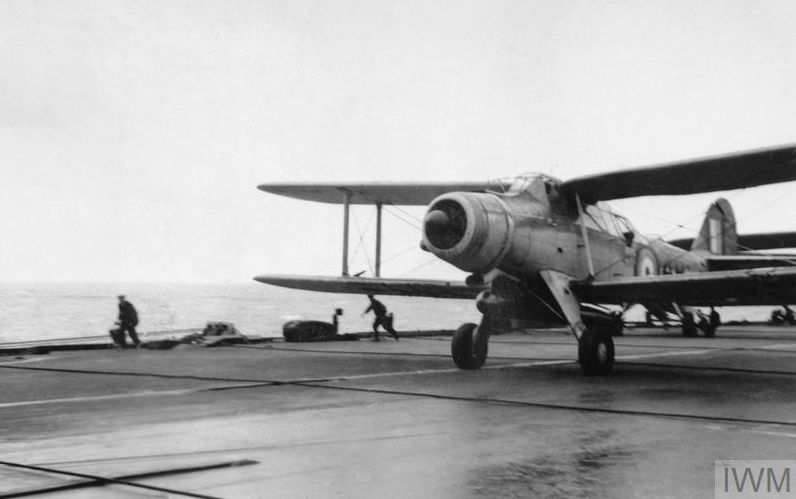 The first torpedo bomber, - A Fairey Albacore Mark I of No. 826 Squadron, - taking off from HMS FORMIDABLE for the morning strike against the Italian Fleet during the Battle of Matapan, 28 March 1941.