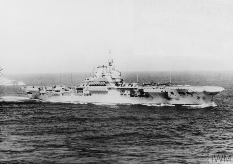 HMS FORMIDABLE at sea in early 1941. Note the Fulmars on her forward deck and the minimalist aft radar mast which would be replaced by a much more complex structure once she underwent repairs inthe US.