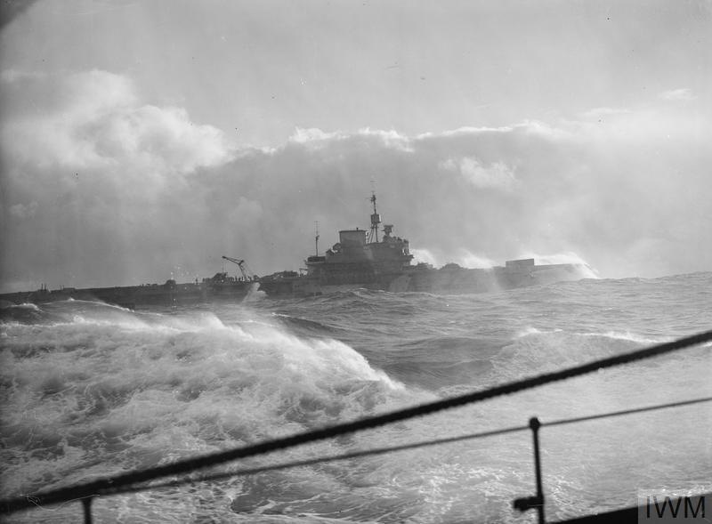 HMS VICTORIOUS steaming through a rough sea.