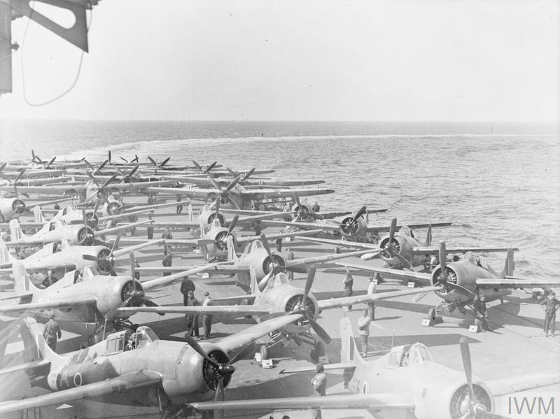 Range of Martlet IV's Fairey Barracudas and Supermarine Seafires on the flight deck of the ILLUSTRIOUS in the North Sea (July 1943).