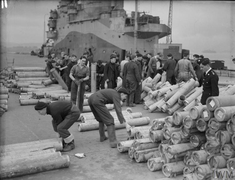 Busy scene on the flight deck of HMS ILLUSTRIOUS during de-ammunitioning, February 21-22, 1943, at Greenock.