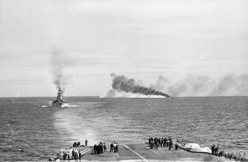 HMS RODNEY and her destroyer laying a smoke-screen, seen from the flight deck of the FORMIDABLE.