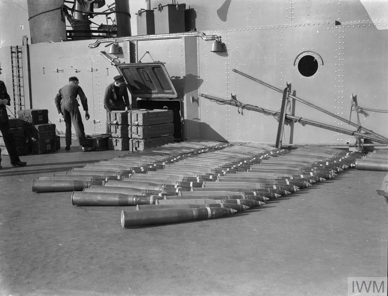 "Some of the 4.5"" ammunition being struck down into the magazine when ammunitioning the ship is in progress. HMS VICTORIOUS, April 1942."