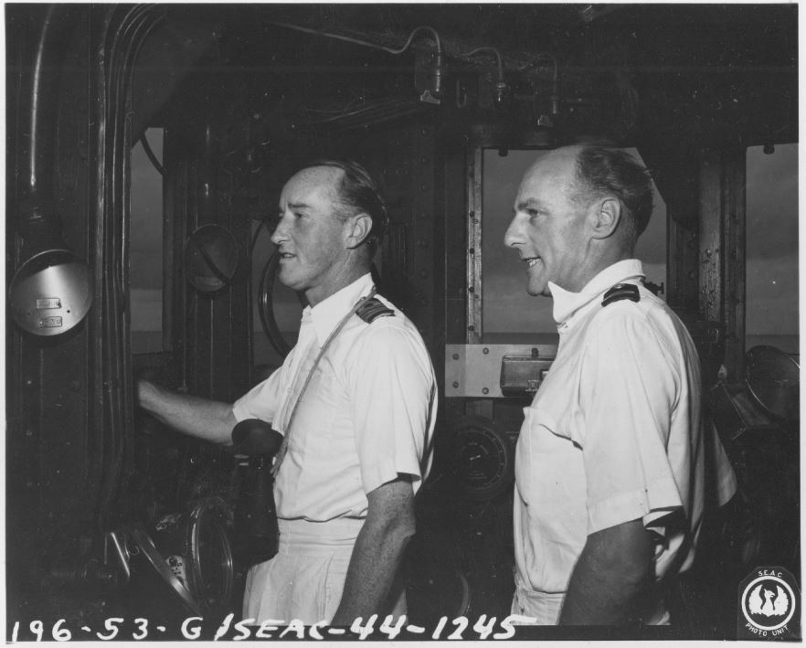 L. to R: Captain Charles Lambe, CB, CVO, and Commander Arthur Wallace on ships bridge (HMS ILLUSTRIOUS). Picture: SEAC Photo Unit (US).