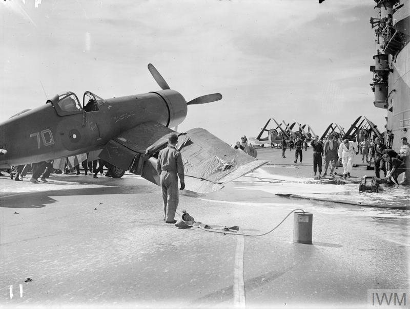 A Chance-Vought Corsair (No JT208, engine no 24293/8694) buckles a wing on landing. HMS ILLUSTRIOUS, May 1944.