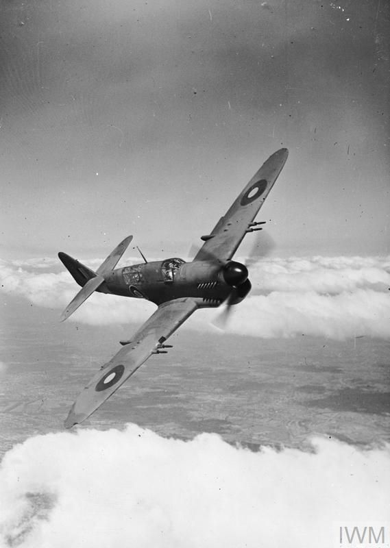 A Fairey Firefly Mark I fighter/maritime reconnaissance aircraft in flight. Close-up, port three-quarter front view.