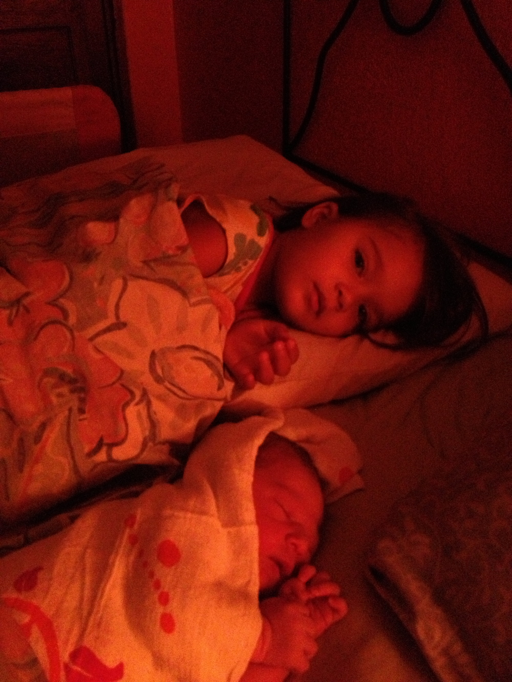 My girls, all three of us snuggled up in bed just hours after Amelie's birth.